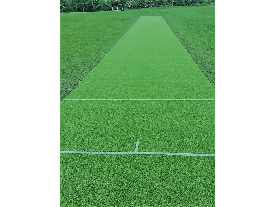 Artificial cricket pitch by Quin Sports & Nets