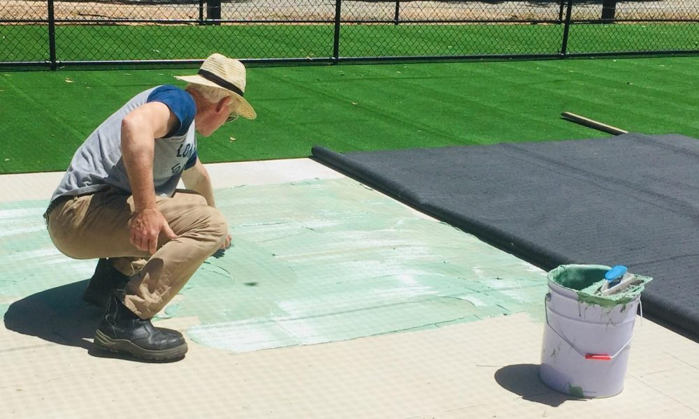 Laying synthetic cricket pitches with waterproof glue